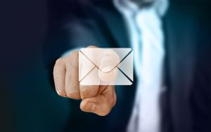 Finger clicking email icon